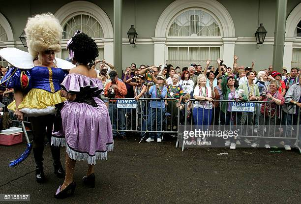 People watch the Bourbon Street Awards for costume design during Mardi Gras festivities February 8 2005 in New Orleans Louisiana Mardi Gras is the...