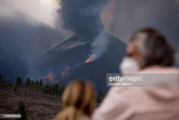 People watch the eruption of Cumbre Vieja volcano as it advances throughout the island, in Tajuya, La Palma, Canary islands, Spain, 23 October 2021....