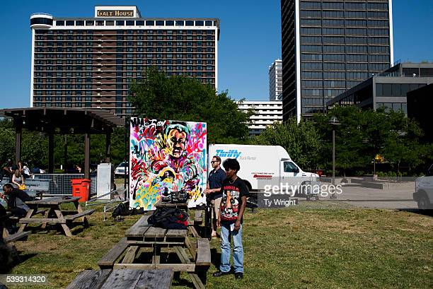 People watch the eulogy for Muhammad Ali on a large screen projector at the Muhammad Ali Center on June 10 2016 in Louisville Kentucky After the...