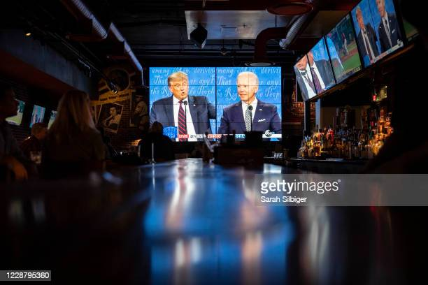People watch the first presidential debate at a Walter's Sports Bar on September 29, 2020 in Washington, DC. Americans across the country tuned in to...