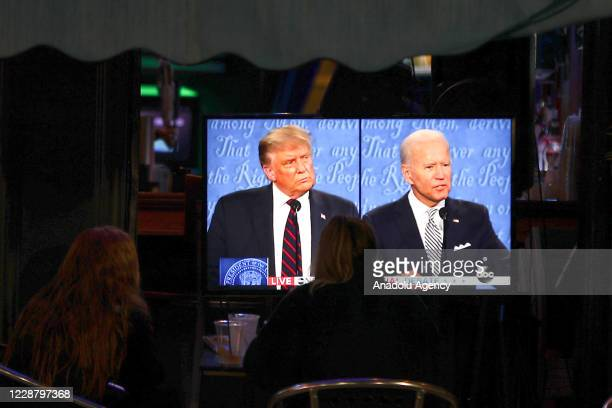 People watch the first presidential debate between U.S. President Donald J. Trump and Former U.S. Vice President Joe Biden, on September 29 in...