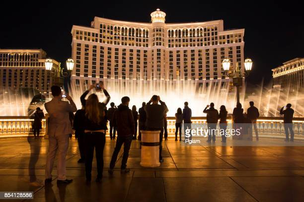 People watch the fountain show at the Bellagio Hotel in Las Vegas Nevada