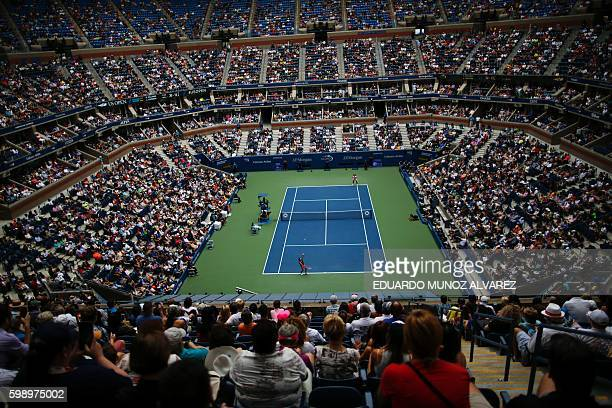 People watch the game at Arthur Ashe Stadium between Serena Williams of US and Johanna Larsson of Sweden during their 2016 US Open women's singles...