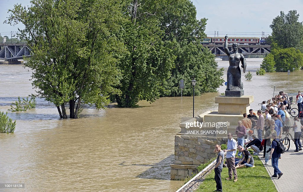 People watch the high water of the Wisla