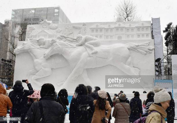 People watch the horse racing snow statue during the opening day of eightday Sapporo Snow Festival in Sapporo on February 4 2019 JAPAN OUT / Japan OUT
