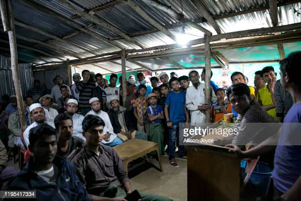 People watch the ICJ hearing at a restaurant in a Rohingya refugee camp on January 23, 2020 in Cox's Bazar, Bangladesh. On Thursday, the...