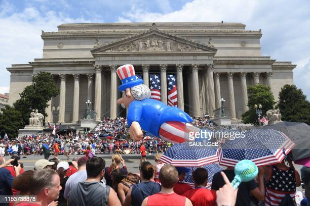 People watch the Independence Day parade as it passes in front of the National Archives in Washington DC on July 4 2019