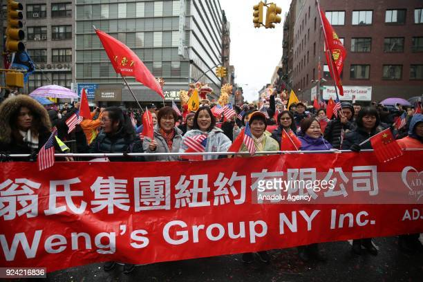People watch the Lunar New Year parade at the Chinatown on February 25 2018 in New York United States 2018 is the ''Year of the Dog'' according to...