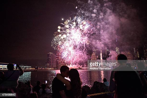 People watch the Macy's Fourth of July Fireworks from Brooklyn Bridge Park on July 4 2015 in the Brooklyn borough of New York City The celebrations...