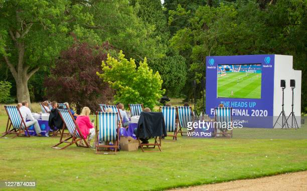 People watch the match as Prince William Duke of Cambridge hosts an outdoor screening of the Heads Up FA Cup final on the Sandringham Estate on...