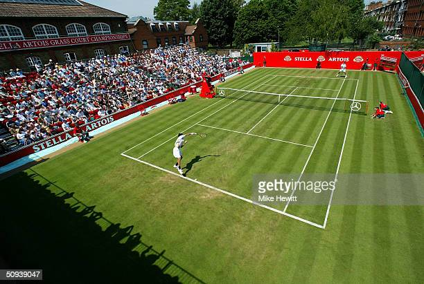 People watch the match between Goran Ivanisevic of Croatia and Victor Hanescu of Romania at the Stella Artois Tennis Tournament at the Queens Club...