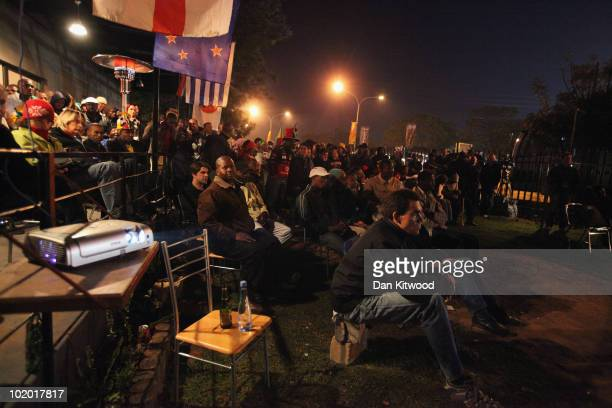 People watch the match on a screen outside the Royal Bafokeng Stadium on June 12 2010 in Rustenburg South Africa England play the USA tonight at the...