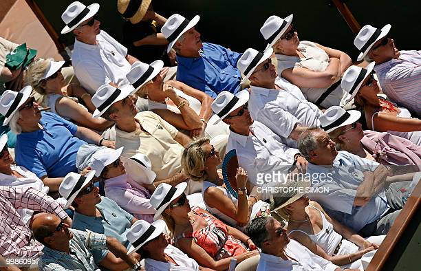 People watch the match opposing Russian Svetlana Kuznetsova to Belgian Justine HeninHardenne during the French tennis Open finals at Roland Garros in...
