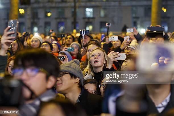 People watch the Mayor of London's New Year firework display in London United Kingdom on January 01 2017