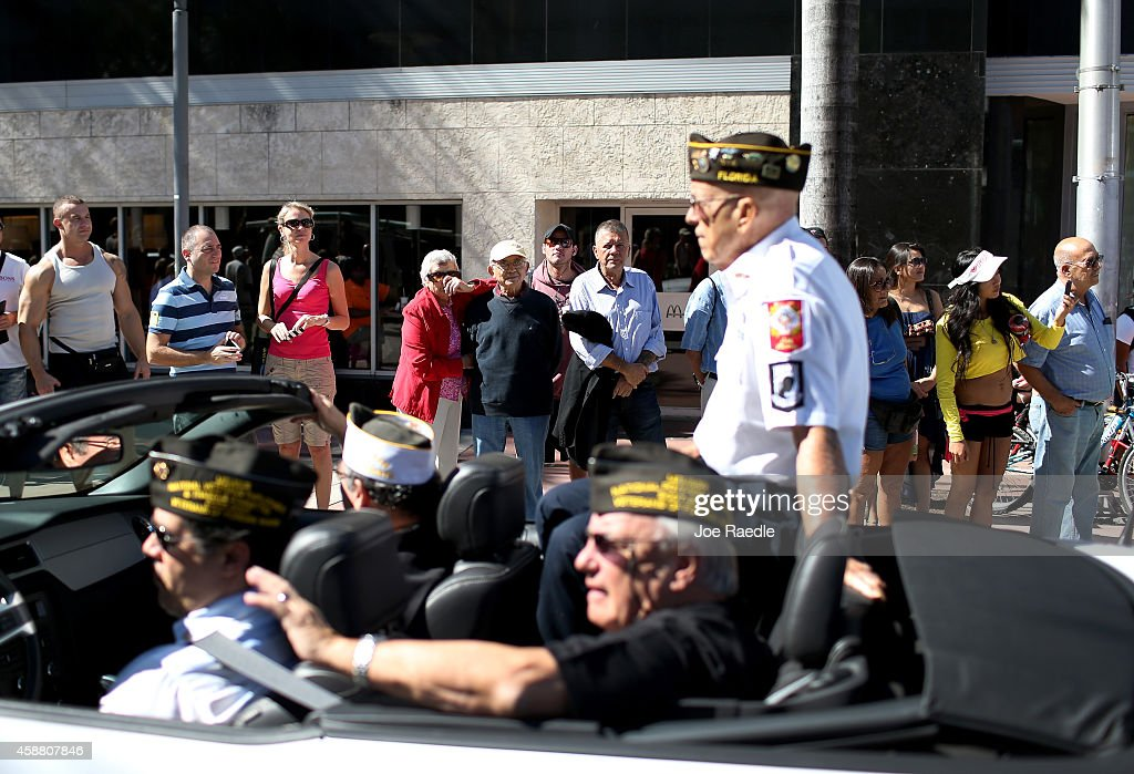 People Watch The Miami Beach Veterans Day Parade Pass By On November 11 2014 In