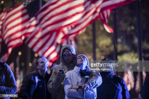 People watch the midterm election primary results on a screen at the Rockefeller Center in New York United States on November 06 2018