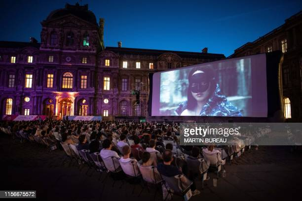 TOPSHOT People watch the movie La Reine Margot at the Louvre Museum during the first of eight screenings of the outdoor cinema Cinema Paradiso Louvre...
