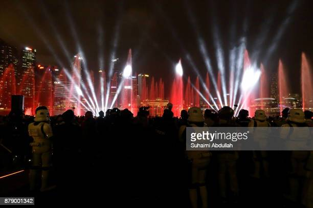 People watch the multimedia light and water show during the launch of the Marina Bay Sands Festive LightUp Star WarsThe Last Jedi Edition at Marina...