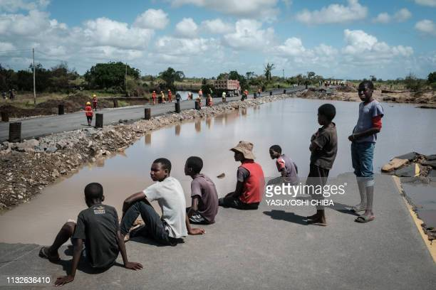 People watch the N6 road rebuilt in three days by China State Construction after the original road was destroyed by the Cyclone Idai in John Segredo...