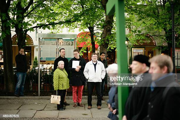 People watch the passing procession during the ecumenical Good Friday procession on April 18 2014 in Berlin Germany Under the theme of 'Reformation...