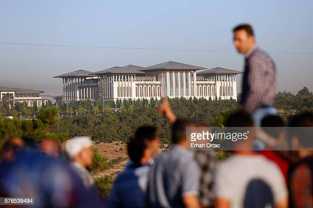 People watch the Presidential Palace July 16 2016 in Ankara Turkey Istanbul's bridges across the Bosphorus the strait separating the European and...