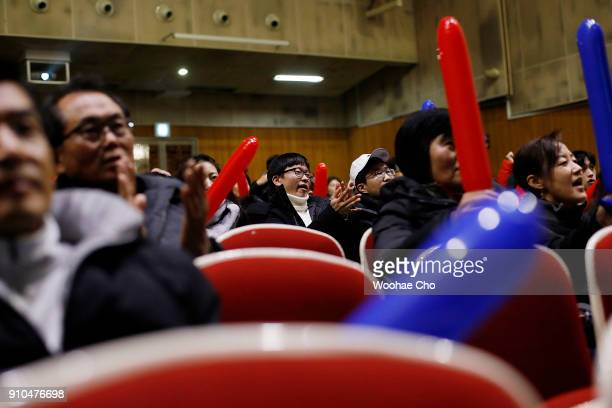 People watch the quarterfinal match between Hyeon Chung and Roger Federer of Australian Open through the TV screen at the auditorium of Seoul High...