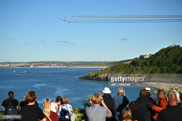People watch the Red Arrows fly over Carbis Bay during the G7 summit in Carbis Bay on June 12, 2021 in Cornwall, United Kingdom. UK Prime Minister,...