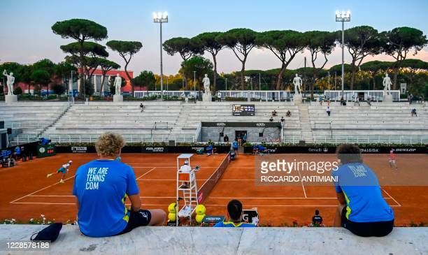 People watch the round 3 match between Italy's Lorenzo Musetti and Germany's Dominik Koepfer on the Pietrangeli court on day five of the Men's...