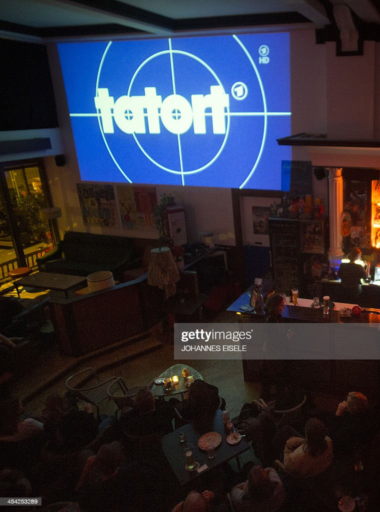 People watch the screening of German TV series 'Tatort' (Scene of Crime) at the 'Volksbar' in Berlin on November 24, 2013. More than 10 million Germans regularly tune in for the hit TV whodunnit 'Tatort' whose popularity with its down-to-earth plots spanning the country has endured for more than four decades.