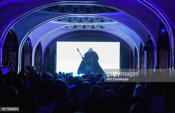 TOPSHOT People watch the seventh season premiere of US TV show 'Game of Thrones' at the Mayakovskaya metro station in Moscow early on July 18 2017...