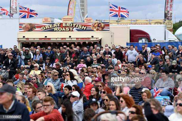 People watch the show from the public area for the British DDay Commemoration on June 05 2019 in Portsmouth England The political heads of 16...