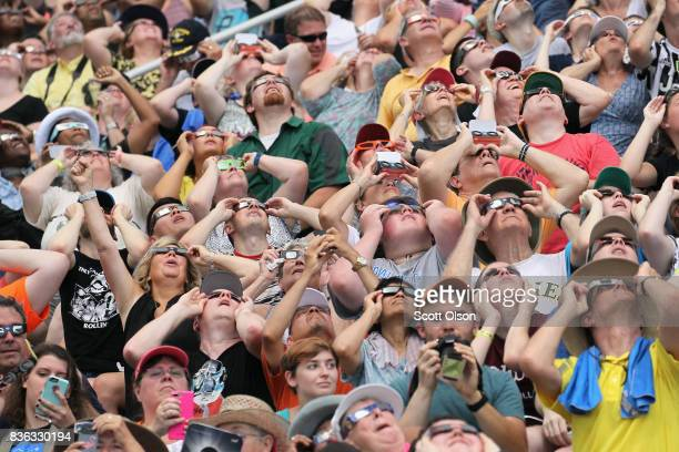 People watch the solar eclipse at Saluki Stadium on the campus of Southern Illinois University on August 21 2017 in Carbondale Illinois Although much...