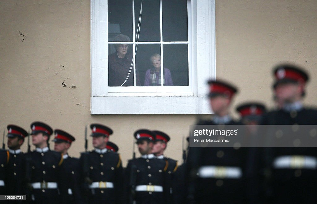 People watch the Sovereign's Parade from a window in the Old College at the Royal Military Academy at Sandhurst on December 14, 2012 in England. The parade marks the completion of 44 weeks of training for 200 young people who will be commissioned into the British Army and the armies of 13 overseas countries. Senior Under Officer Sarah Hunter-Choat became the fourth woman in the Royal Military Academy's history to receive the prestigious Sword of Honour which is awarded to the best Officer Cadet on the course.