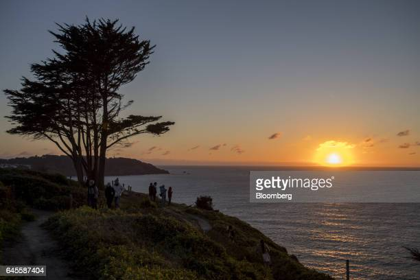 People watch the sunset from Fort Scott at the Presidio in San Francisco California US on Thursday Feb 23 2017 With President Donald Trump's...