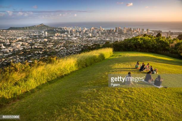 people watch the sunset over honolulu hawaii - lookout tower stock pictures, royalty-free photos & images