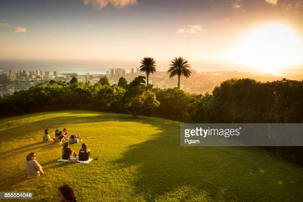 people watch the sunset over honolulu hawaii - diamond head stock photos and pictures