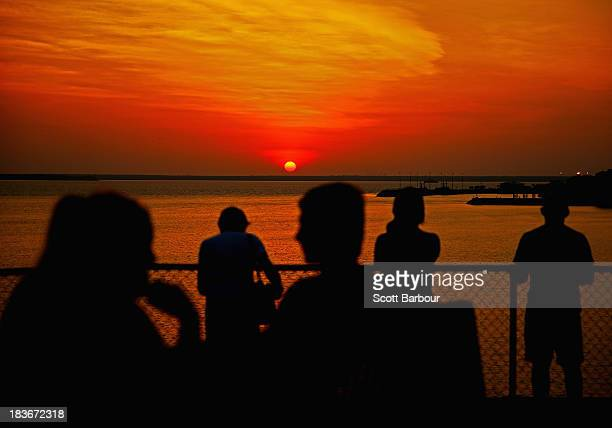 People watch the sunset over Port Darwin from Bicentennial Park on October 6 2013 in Darwin Australia Darwin is the capital of the Northern Territory...