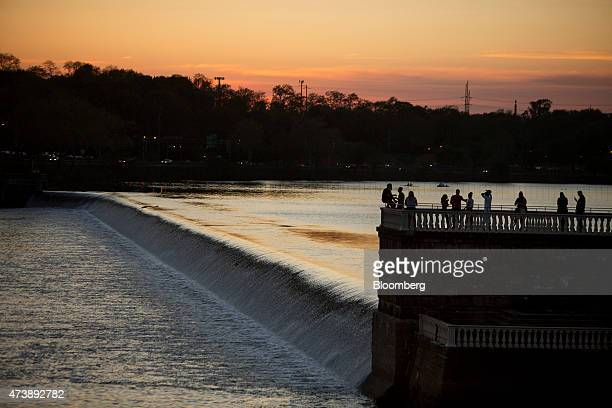 People watch the sunset over the Schuylkill River in Philadelphia Pennsylvania US on Friday May 8 2015 Philadelphia the largest city in the...