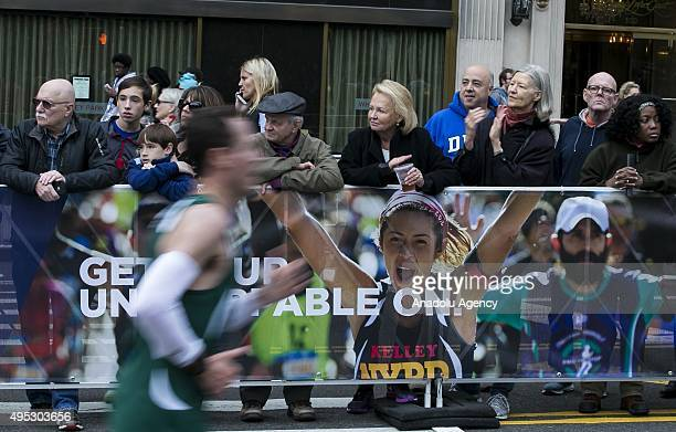 People watch the TCS New York City Marathon on November 1 2015 in New York City