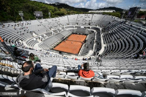 People watch the the eigh quarter tennis match Serbia's Novak Djokovic against Spain's Alejandro Davidovich on the central court during the Men's...