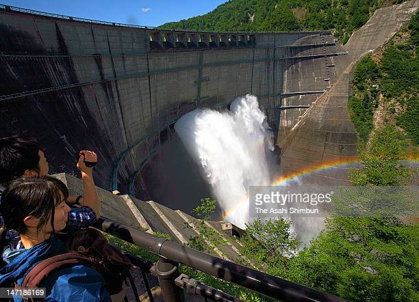 People watch the trailwater from Kurobe Dam on June 26 2012 in Tateyama Toyama Japan The watering will be until October 15