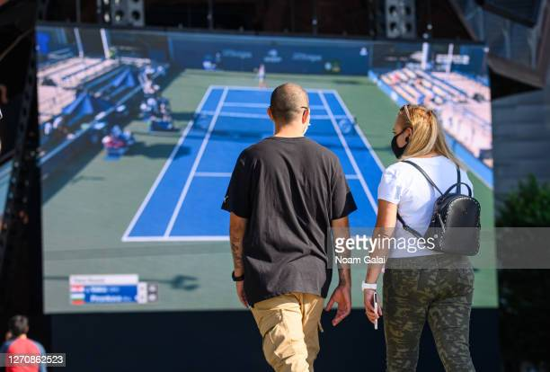 People watch the US Open on a big screen at the Backyard in Hudson Yards as the city continues Phase 4 of re-opening following restrictions imposed...