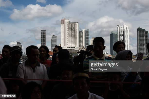 People watch the vote count for the Jakarta Governor election on February 15 2017 in Jakarta Indonesia Residents of Indonesia's capital went to the...
