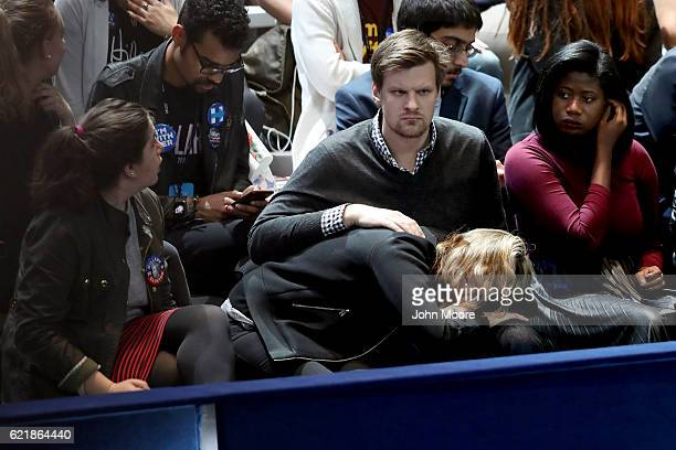People watch the voting results at Democratic presidential nominee former Secretary of State Hillary Clinton's election night event at the Jacob K...