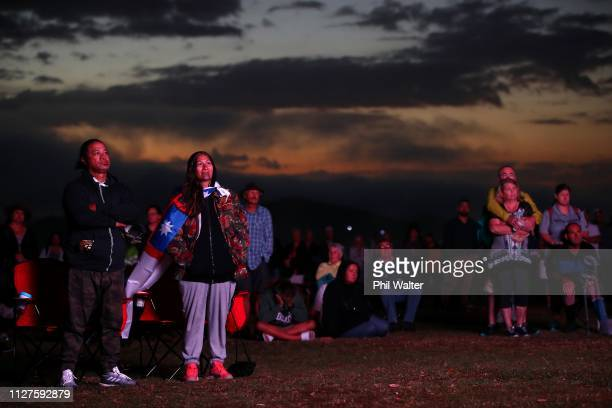 People watch the Waitangi Day Dawn Service as the sun rises at the Whare Runanga on February 06 2019 in Waitangi New Zealand The Waitangi Day...