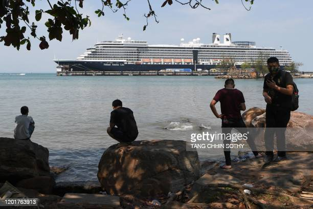 People watch the Westerdam cruise ship in Sihanoukville on February 19 2020 Dozens of passengers stuck for nearly a week on a US cruise ship in...