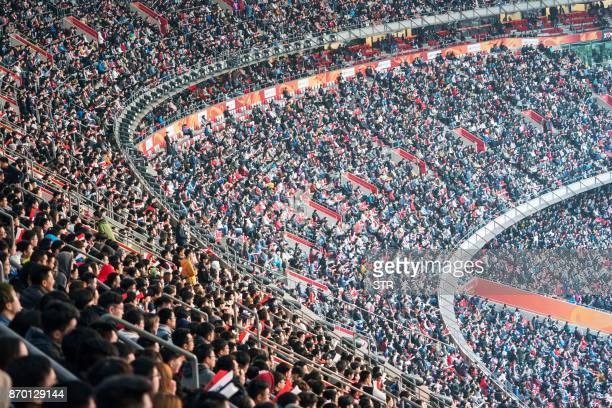 People watch the World Championships Final of League of Legends at the National Stadium 'Bird's Nest' in Beijing on November 4, 2017. - The final of...