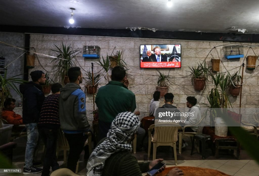 People watch US President Donald Trump's speech regarding the recognition of Jerusalem as Israels capital, from televisions at a cafe in Gaza, Gaza City on December 06, 2017.