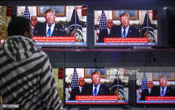 People watch US President Donald Trump's speech regarding the recognition of Jerusalem as Israels capital from televisions in Gaza Gaza City on...