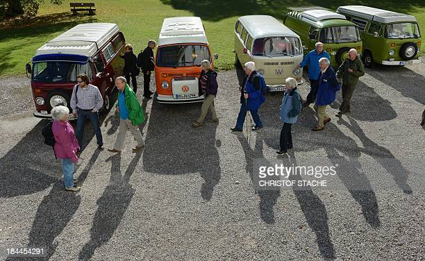 People watch vintage Volkswagen buses during an autumn rally of socalled 'Bulli' enthousiasts in front of the abbey Schaeftlarn near Munich southern...
